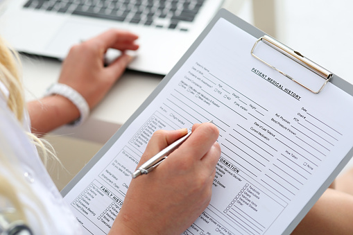filling out patient forms